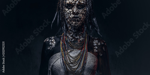 Fotografiet  Close-up portrait of a witch from the indigenous African tribe, wearing traditional costume