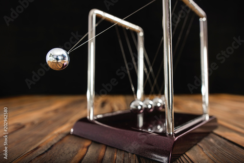 Valokuvatapetti Concept for Action and Reaction in Business with Newton's Cradle