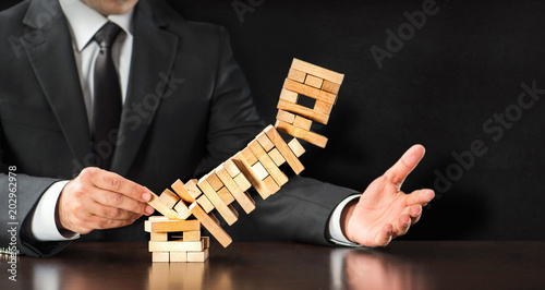 Fotografía  Businessman Fails Building Tower, Concept For Challenge And Fail In Business
