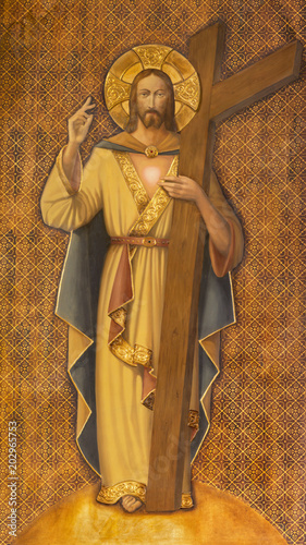 Obraz na plátně ZARAGOZA, SPAIN - MARCH 1, 2018:  The painting of Resurrected Jesus Christ with the cross in church Iglesia del Perpetuo Socorro by pater Jesus Faus (1953 - 1959)