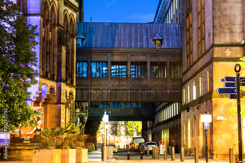 Illuminated old historical buildings in the city center of Manchester, UK at nig Canvas Print