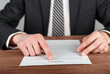 Businessman reading terms and conditions of business contract