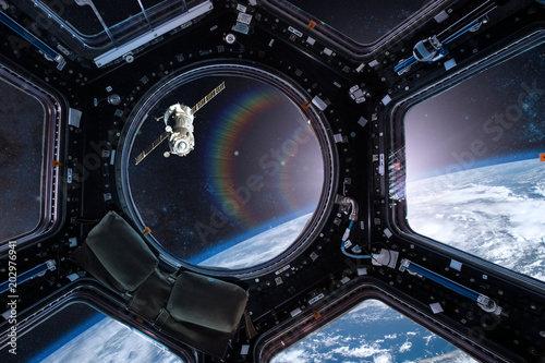 Photo View from a porthole of space station on the Earth background