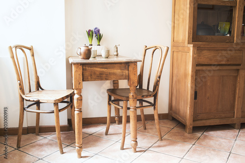 Vintage Interior Design Of Kitchen Space With Small Table Against