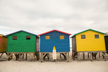 Multi Colored Wooden Huts On S...