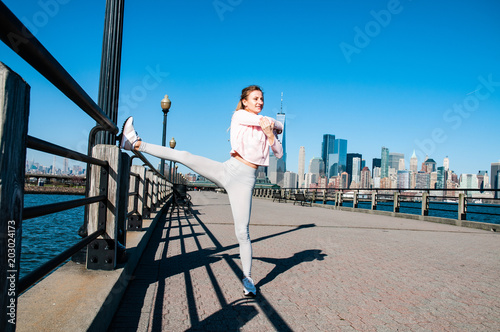Fotografie, Obraz  Sports woman makes warm up and stretching before morning run
