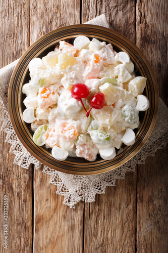 fruit salad Ambrosia from pineapple, tangerine, grapes and marshmelow close-up Tableau sur Toile