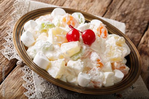 Organic healthy fruit salad Ambrosia with marshmallow and vanilla yogurt close-up Canvas Print