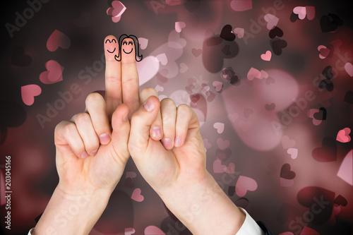 Fototapeta Fingers crossed like a couple against valentines heart design obraz na płótnie
