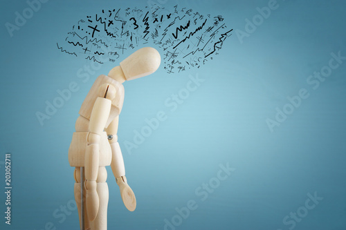image of wooden dummy with worried stressed thoughts Wallpaper Mural