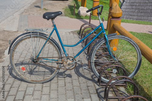 Recess Fitting Bicycle Old Ussr vintage retro bicycle at spring. Travel photo.