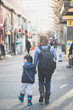 Asian mother and her son walking in city