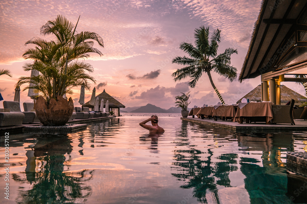 Fototapety, obrazy: young man at the beach during vacation at the tropical islands of the Seychelles