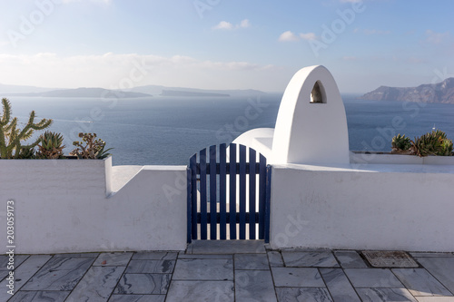 Aluminium Prints Santorini Blue door overlooking the Mediterranean sea in Santorini