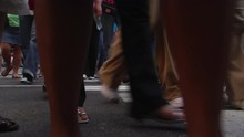 Close-up Of Feet Hurrying Over Crosswalk Near Times Square