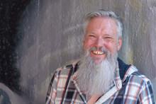 Happy Jovial Man With A Long Beard