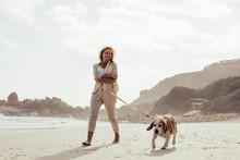 Mature Woman Walking Her Dog O...
