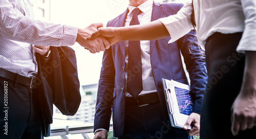 Photo  handshake of business People Colleagues Teamwork Meeting