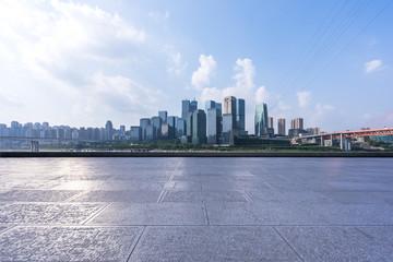 empty marble floor with city skyline