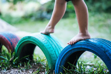 Kids  Running On Tires In The...