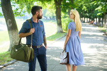 Man With Beard And Blonde Girl Stopped To Get Acquainted.