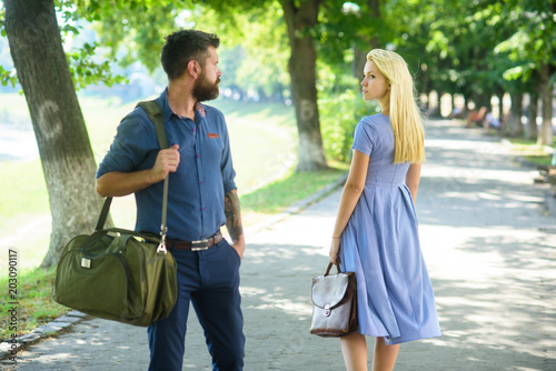 Man with beard and blonde girl stopped to get acquainted. фототапет
