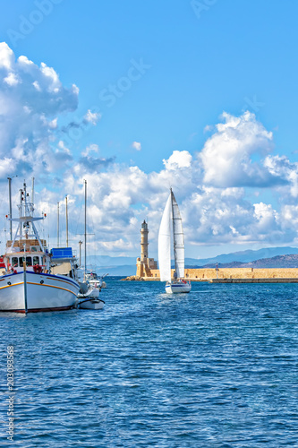 Poster Mediterraans Europa Yacht on background of Lighthouse in the Old Venetian Harbour in Chania . Crete. Greece.