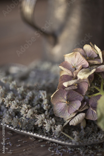 Close-up of dry hydrangea with lavender on wooden table