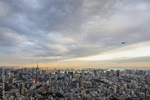 Aerial view of cityscape against cloudy sky during sunset