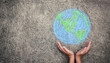 canvas print picture - Closeup hands holding earth draw with chalk. World harmony green peace environment earth day together concept banner.