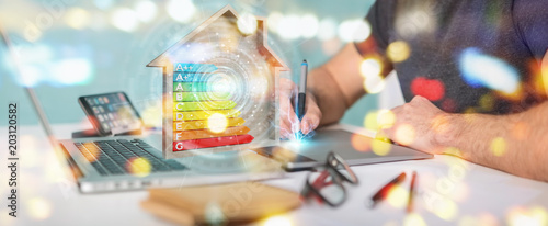 Fotografía Graphic designer using 3D rendering energy rating chart in a wooden house