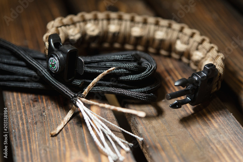 Fotografiet  Bracelets made of rope braided (paracord) and carabiners with a compass