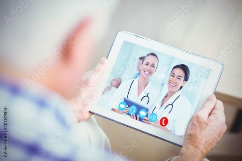 Fényképezés  Nurses with tablet pc against senior man using tablet