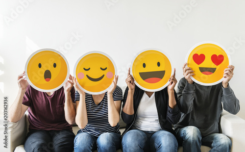 Fotografie, Obraz  Diverse people holding emoticon