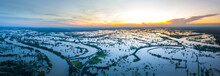 Top View Aerial Photo From Flying Drone Over Rice Field In Thailand.Top View Beautiful Sunset.Northeastern Rice Flood.