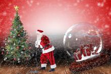 Santa Pulling Snow Globe Of Pr...