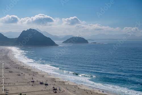 view of Copacabana and Leme beach during early morning, taken from the rooftop of a hotel, some slight fog can be seen on the blue sky Wallpaper Mural