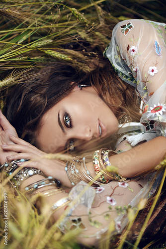 Gypsy girl lying in grass