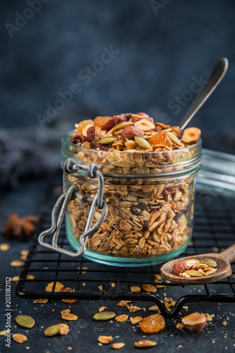 Photo  homemade granola (hazelnuts, raisin, dried cranberry, pumpkin, sesame and sunflo