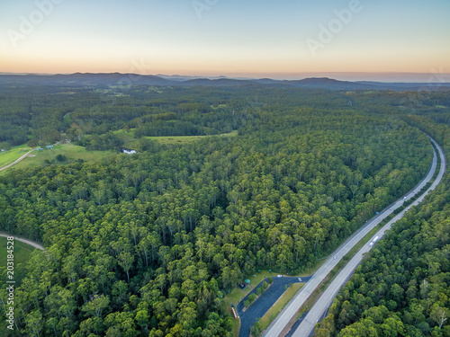 Foto op Canvas Khaki Pacific Highway and native Australian forest at sunset