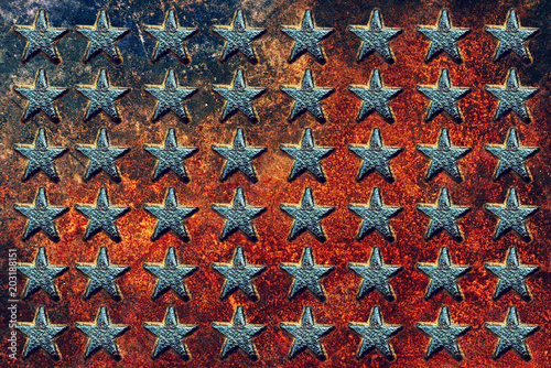 Valokuva  Embossed USA star shapes on rusty metal surface