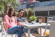 canvas print picture - Happy young couple seating relaxed in a restaurant terrace