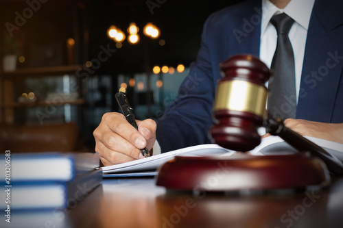 Close up lawyer businessman working or reading lawbook in office workplace for consultant lawyer concept Poster Mural XXL