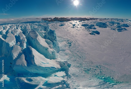 Staande foto Antarctica Panorama on icebergs and ice on the water in front of him, terrain and scenery Antarctic , day, sunset.