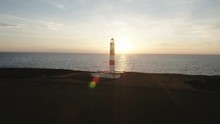Aerial Drone Shot Of Tarbat Ness Lighthouse In Scotland During A Sunset