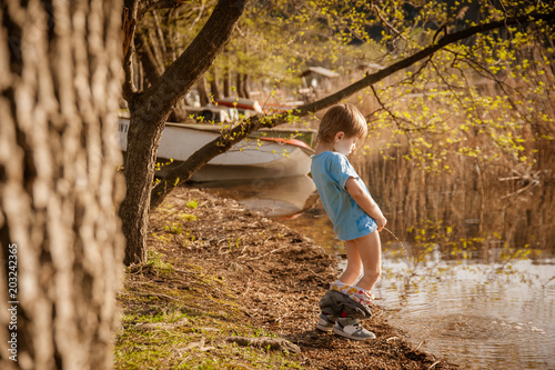 blond child pee in the lake Wallpaper Mural