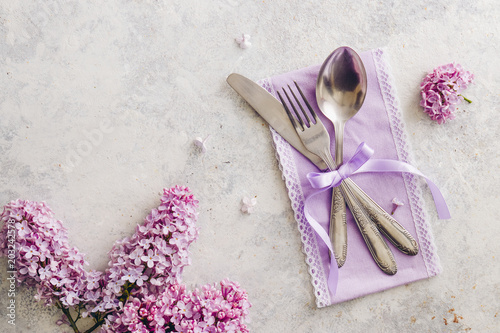 Spring table decoration with lilac flowers