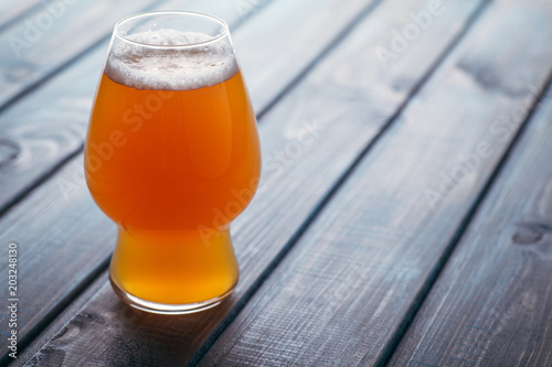 Pale ale on blue wood Wallpaper Mural