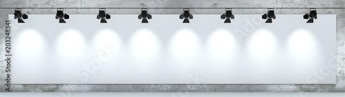 Photo Cartellone pubblicitario bianco, illuminato da faretti appeso ad un muro