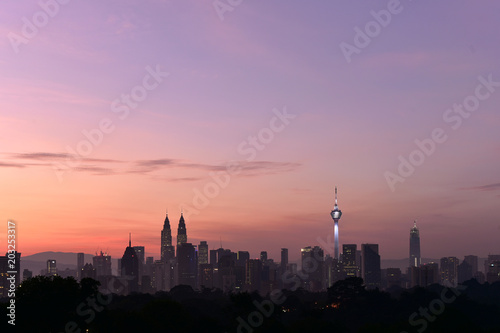 beautiful landscape view of Kuala Lumpur cityscape skyline with sunrise view in dawn and buildings in silhouette